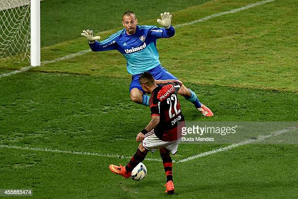 Everton of Flamengo struggles for the ball with goalkeeper Diego Cavalieri of Fluminense during a match between Flamengo and Fluminense as part of...