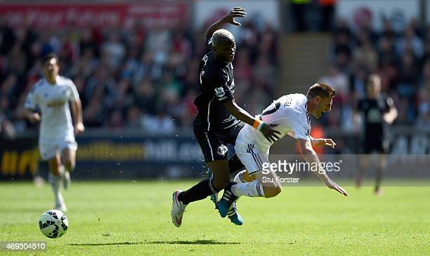 Everton player Arouna Kone challenges Angel Rangel of Swansea during the Barclays Premier League match between Swansea City and Everton at Liberty...