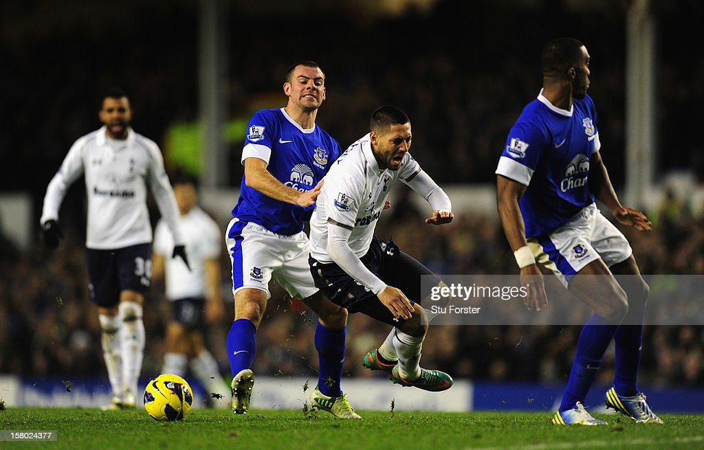 Everton player Darren Gibson (l) upends Spurs player Clint Dempsey during the Barclays Premier between Everton and Tottenham Hotspur at Goodison Park on December 9, 2012 in Liverpool, England.