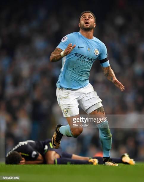 Everton player Dominic CavertLewin is left on the floor after a challenge from Kyle Walker of Manchester City leads to him being sent off during the...