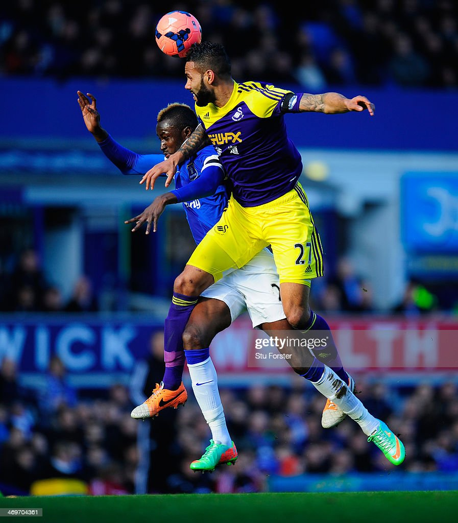 Everton player <a gi-track='captionPersonalityLinkClicked' href=/galleries/search?phrase=Lacina+Traore&family=editorial&specificpeople=6515667 ng-click='$event.stopPropagation()'>Lacina Traore</a> (l) is challenged by Kyle Bartley during the FA Cup Fifth Round match between Everton and Swansea City at Goodison Park on February 16, 2014 in Liverpool, England.