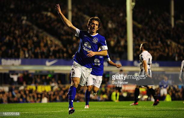 Everton player Leighton Baines celebrates the first goal during the Premier League match between Everton and Newcastle United at Goodison Park on...