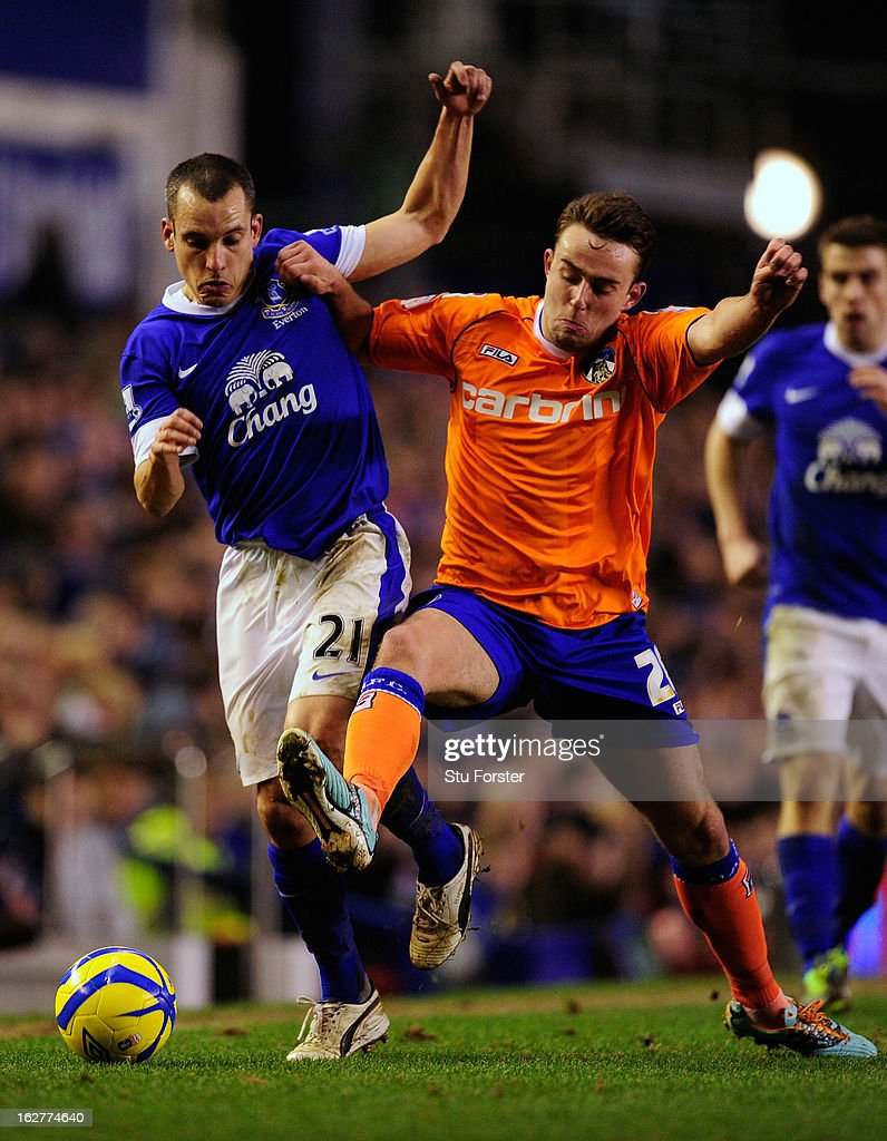 Everton player <a gi-track='captionPersonalityLinkClicked' href=/galleries/search?phrase=Leon+Osman&family=editorial&specificpeople=208939 ng-click='$event.stopPropagation()'>Leon Osman</a> (l) is challenged by Oldham player <a gi-track='captionPersonalityLinkClicked' href=/galleries/search?phrase=Jose+Baxter&family=editorial&specificpeople=5015103 ng-click='$event.stopPropagation()'>Jose Baxter</a> during the FA Cup Fifth Round Replay between Everton and Oldham Athletic at Goodison Park on February 26, 2013 in Liverpool, England.