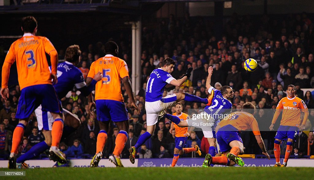 Everton player <a gi-track='captionPersonalityLinkClicked' href=/galleries/search?phrase=Leon+Osman&family=editorial&specificpeople=208939 ng-click='$event.stopPropagation()'>Leon Osman</a> (21) scores the third Everton goal during the FA Cup Fifth Round Replay between Everton and Oldham Athletic at Goodison Park on February 26, 2013 in Liverpool, England.