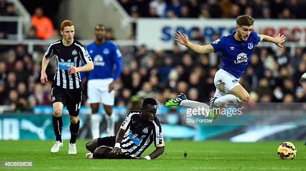 Everton player Luke Garbutt rides a tackle from Chieck Tiote of Newcastle during the Barclays Premier League match between Newcastle United and...