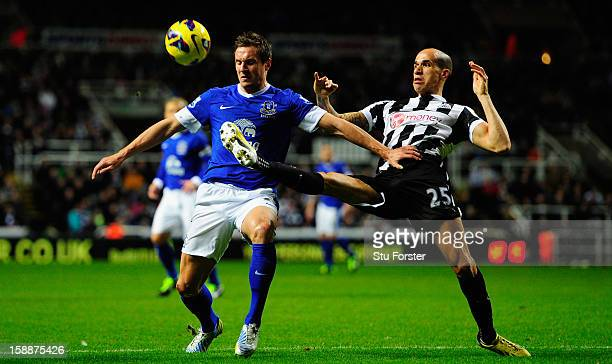 Everton player Phil Jagielka is challenged by Gabriel Obertan during the Barclays Premier League match between Newcastle United and Everton at St...