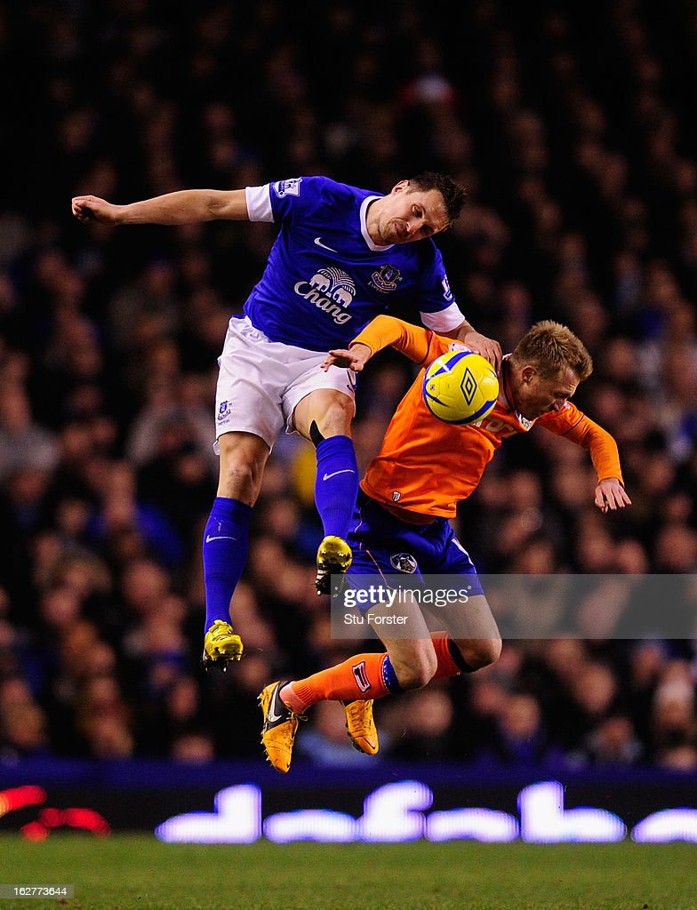 Everton player <a gi-track='captionPersonalityLinkClicked' href=/galleries/search?phrase=Phil+Jagielka&family=editorial&specificpeople=682518 ng-click='$event.stopPropagation()'>Phil Jagielka</a> (l) is challenged by Oldham player <a gi-track='captionPersonalityLinkClicked' href=/galleries/search?phrase=Lee+Barnard&family=editorial&specificpeople=647042 ng-click='$event.stopPropagation()'>Lee Barnard</a> during the FA Cup Fifth Round Replay between Everton and Oldham Athletic at Goodison Park on February 26, 2013 in Liverpool, England.