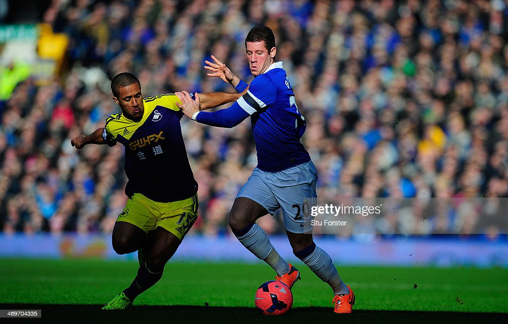 Everton player <a gi-track='captionPersonalityLinkClicked' href=/galleries/search?phrase=Ross+Barkley&family=editorial&specificpeople=5806369 ng-click='$event.stopPropagation()'>Ross Barkley</a> (r) challenges <a gi-track='captionPersonalityLinkClicked' href=/galleries/search?phrase=Wayne+Routledge&family=editorial&specificpeople=206672 ng-click='$event.stopPropagation()'>Wayne Routledge</a> of Swansea during the FA Cup Fifth Round match between Everton and Swansea City at Goodison Park on February 16, 2014 in Liverpool, England.