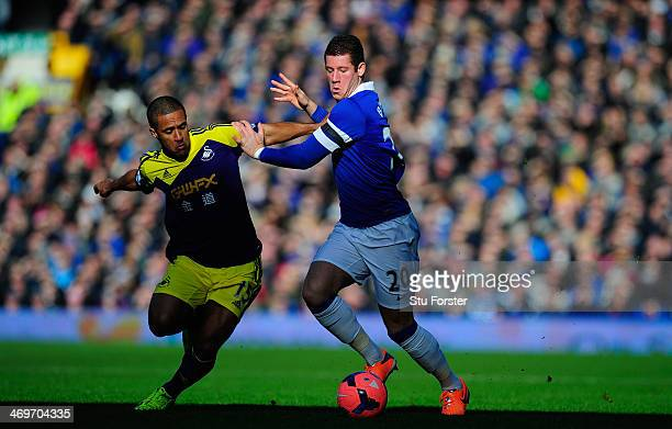 Everton player Ross Barkley challenges Wayne Routledge of Swansea during the FA Cup Fifth Round match between Everton and Swansea City at Goodison...