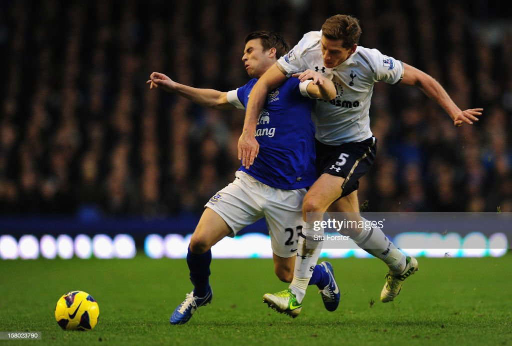Everton player Seamus Coleman (l) is brought down by Spurs player Jan Vertonghen during the Barclays Premier between Everton and Tottenham Hotspur at Goodison Park on December 9, 2012 in Liverpool, England.