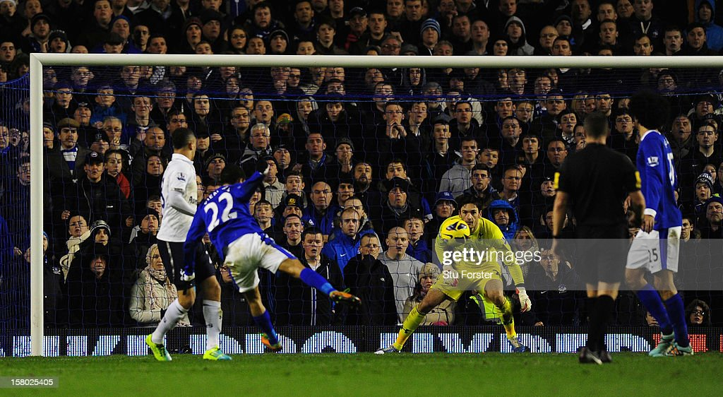 Everton player Steven Pienaar (22) scores the first Everton goal during the Barclays Premier League match between Everton and Tottenham Hotspur at Goodison Park on December 9, 2012 in Liverpool, England.