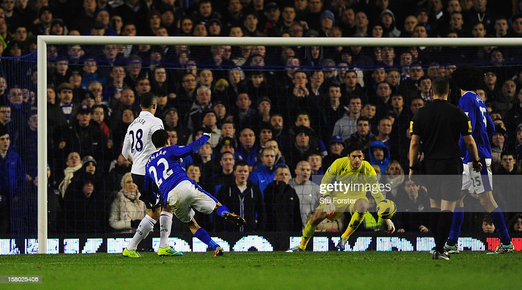Everton player <a gi-track='captionPersonalityLinkClicked' href=/galleries/search?phrase=Steven+Pienaar&family=editorial&specificpeople=787271 ng-click='$event.stopPropagation()'>Steven Pienaar</a> (22) scores the first Everton goal during the Barclays Premier League match between Everton and Tottenham Hotspur at Goodison Park on December 9, 2012 in Liverpool, England.