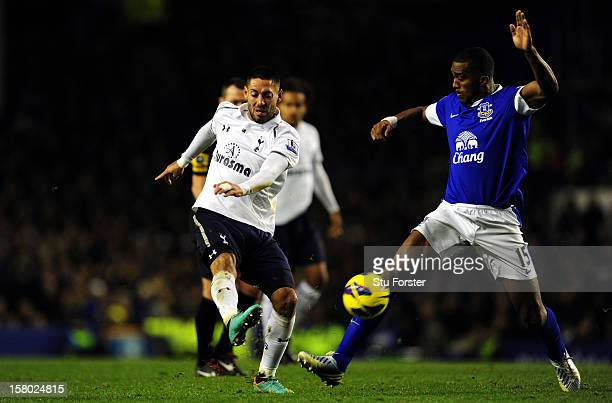 Everton player Sylvain Distin can only watch as Spurs player Clint Dempsey scores the opening goal during the Barclays Premier game between Everton...