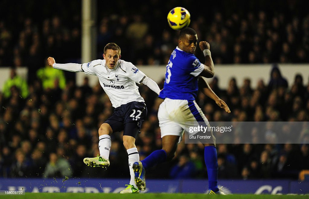 Everton player Sylvain Distin can only watch as Spurs player Gylfi Sigurdsson gets in a shot at goal during the Barclays Premier game between Everton and Tottenham Hotspur at Goodison Park on December 9, 2012 in Liverpool, England.