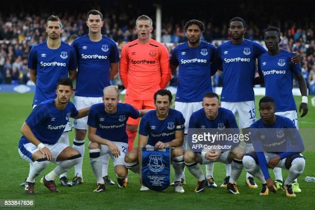 Everton players Everton's French midfielder Morgan Schneiderlin Everton's English defender Michael Keane Everton's English goalkeeper Jordan Pickford...