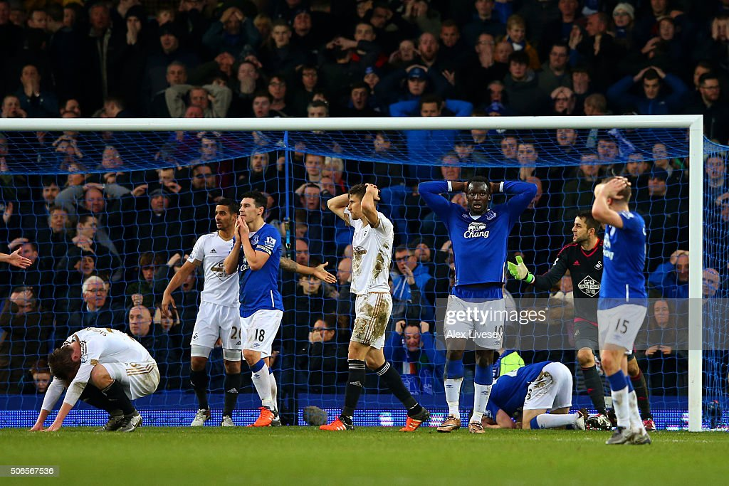 Everton players, including Romelu Lukaku and Gareth Barry, react after Seamus Coleman missed an opportunity late in the Barclays Premier League match between Everton and Swansea City at Goodison Park on January 24, 2016 in Liverpool, England.