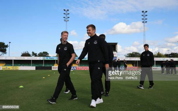 Everton players Jordan Thorniley and Harry Charsley inspect the pitch Rhyl