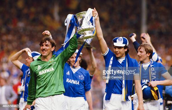 Everton players Neville Southall and striker Graeme Sharp lift the trophy after their 1984 FA Cup final victory against Watford at Wembley Stadium on...