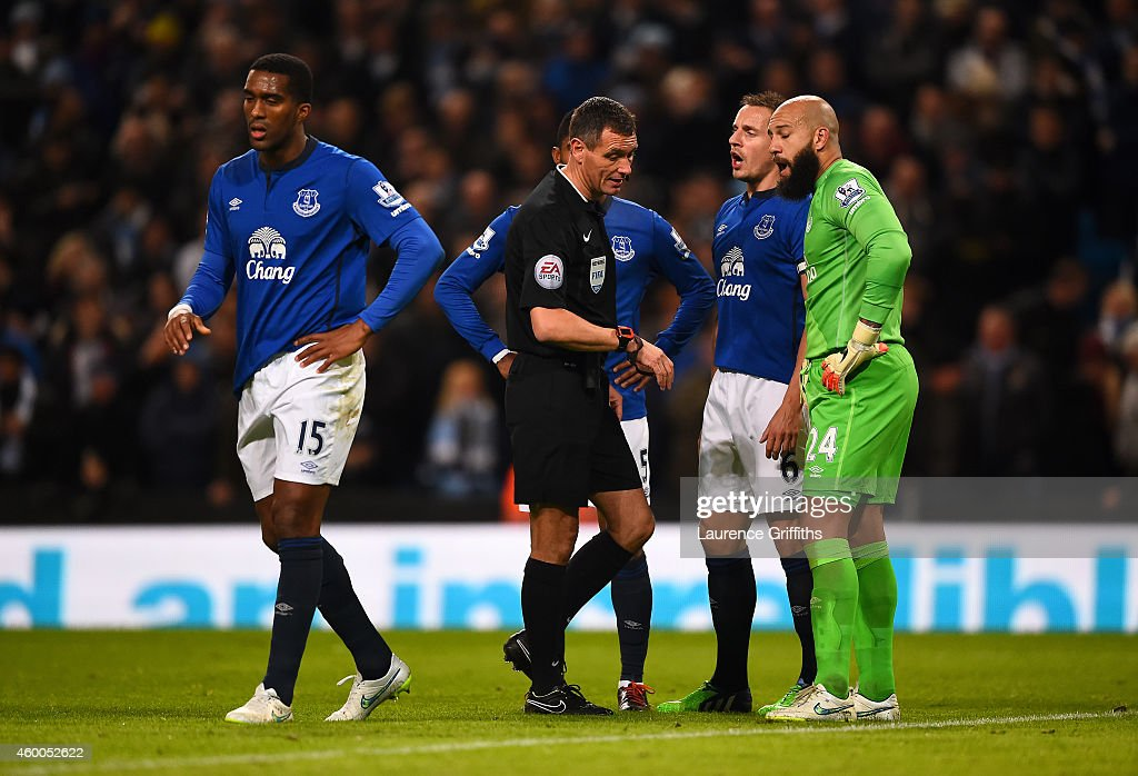 Everton players speak with referee Andre Marriner during the Barclays Premier League match between Manchester City and Everton at Etihad Stadium on...