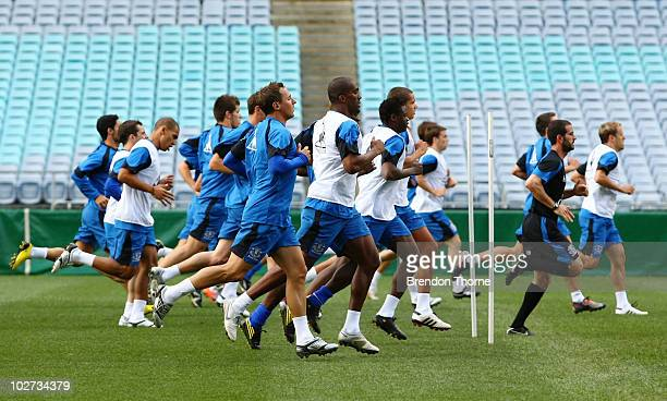 Everton players warm up during the Evertone training session at ANZ Stadium on July 9 2010 in Sydney Australia