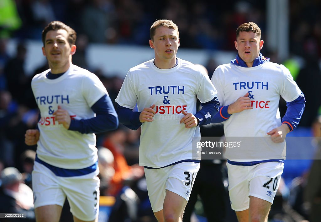 Everton players wearing shirts to commemorate the Hillsborough disaster victims warm up prior to the Barclays Premier League match between Everton and A.F.C. Bournemouth at Goodison Park on April 30, 2016 in Liverpool, England.