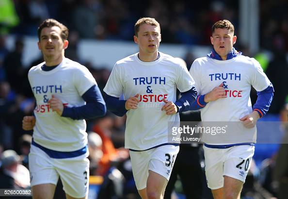 Everton players wearing shirts to commemorate the Hillsborough disaster victims warm up prior to the Barclays Premier League match between Everton...