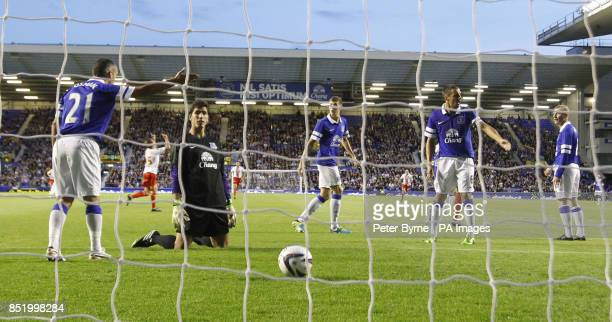Everton react after conceding a goal to Accrington Stanley's Luke Freeman during the Capital One Cup Second Round match at Goodison Park Liverpool
