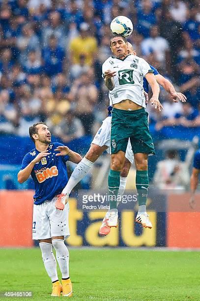 Everton Ribeiro and Nilton of Cruzeiro and Ramon of Goias battle for the ball during a match between Cruzeiro and Goias as part of Brasileirao Series...