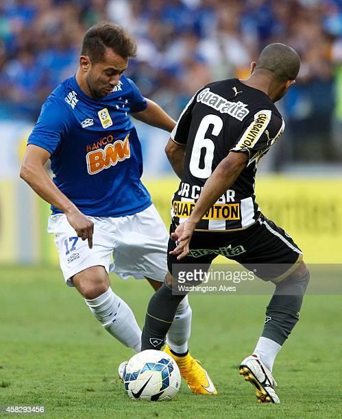 Everton Ribeiro Junior Cesar#6 of Cruzeiro struggles for the ball with Junior Cesar of Botafogo during a match between Cruzeiro and Botafogo as part...