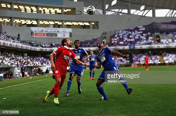 Everton Ribeiro of Al Ahli and Mahamoud Khamis Al Hammadi of Al Nasr challenge for the ball during the President's Cup Final between Al Ahli and Al...