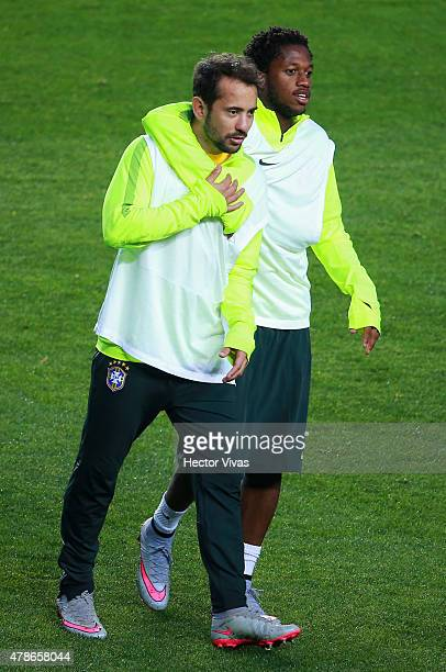 Everton Ribeiro of Brazil walks with a teammate during a training session at Ester Roa Rebolledo Stadium on June 26 2015 in Concepcion Chile Brazil...