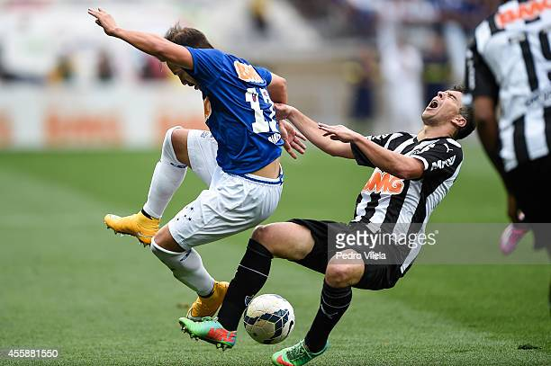 Everton Ribeiro of Cruzeiro and Leandro Donizete of Atletico MG battle for the ball during a match between Cruzeiro and Atletico MG as part of...