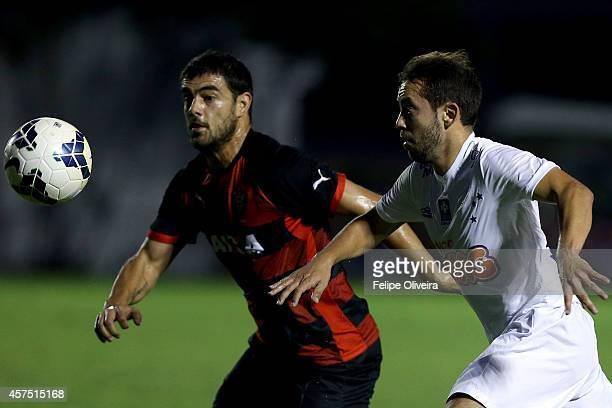 Everton Ribeiro of Cruzeiro battles for the ball with Luis Aguiar of Vitoria during the match between Vitoria and Cruzeiro as part of Brasileirao...