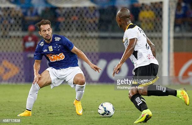 Everton Ribeiro of Cruzeiro struggles for the ball with Luis Felipe of Criciuma during a match between Cruzeiro and Criciuma as part of Brasileirao...