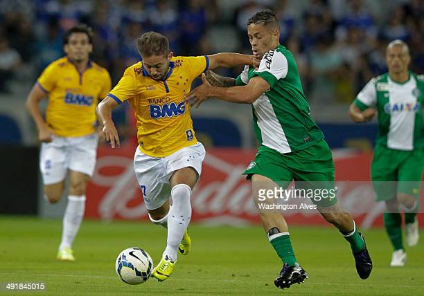 Everton Ribeiro of Cruzeiro struggles for the ball with Souza of Coritiba during a match between Cruzeiro and Coritiba as part of Brasileirao Series...