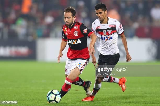 Everton Ribeiro of Flamengo struggles for the ball with Jorginho of Atletico GO during a match between Flamengo and Atletico GO part of Brasileirao...