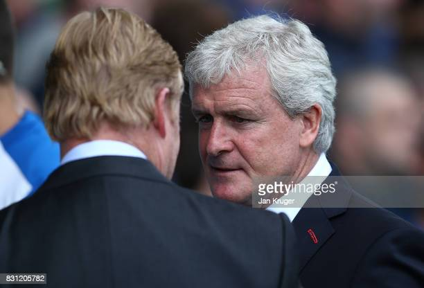 Everton Ronald Koeman chats with Stoke City manager Mark Hughes during the Premier League match between Everton and Stoke City at Goodison Park on...