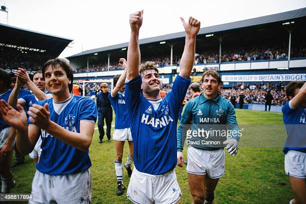 Everton skipper Kevin Ratcliffe Graeme Sharp and Neville Southall do a lap of honour after Everton had beaten Queens Park Rangers 20 at Goodison Park...