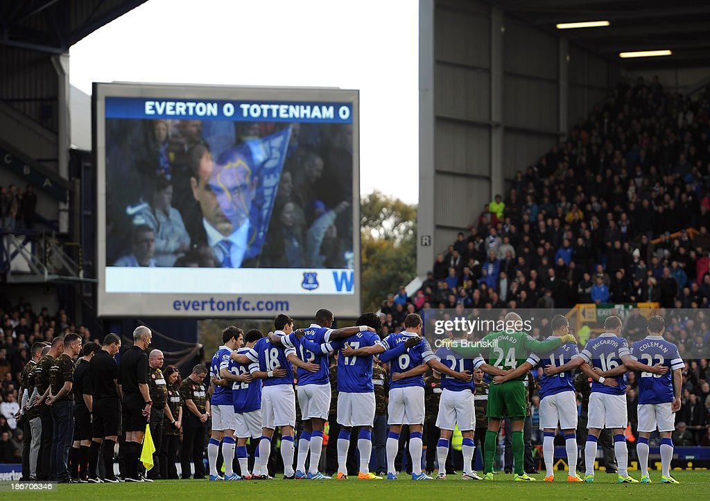Everton stand for a minute's silence to commemorate Remembrance Sunday prior to the Barclays Premier League match between Everton and Tottenham Hotspur at Goodison Park on November 03, 2013 in Liverpool, England.