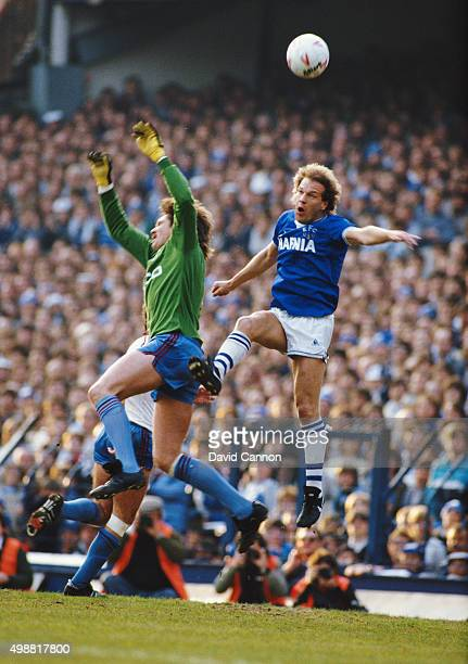 Everton striker Andy Gray challenges West Ham United goalkeeper Phil Parkes during a First Division match at Goodison Park on May 8 1985 in Liverpool...