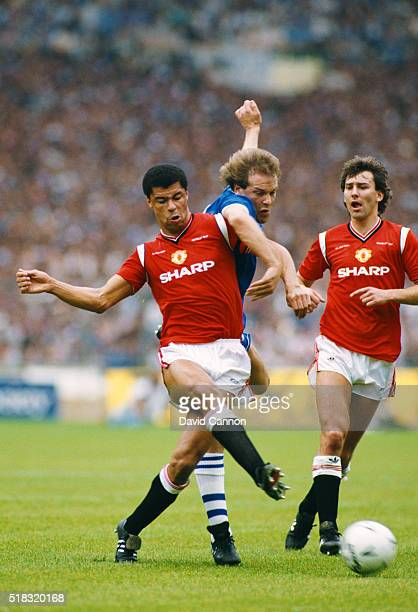 Everton striker Andy Gray is challenged by Paul McGrath as Bryan Robson looks on during the 1985 FA Cup Final between Everton and Manchester United...