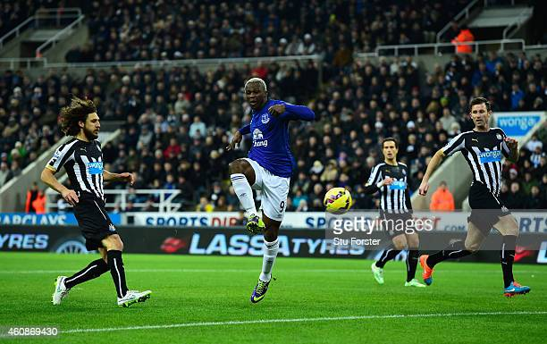 Everton striker Arouna Kone scores the first goal during the Barclays Premier League match between Newcastle United and Everton at St James' Park on...