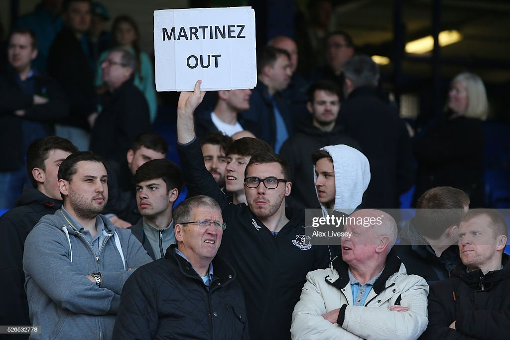 Everton supporters hold banner 'Martinez Out'' after the Barclays Premier League match between Everton and A.F.C. Bournemouth at Goodison Park on April 30, 2016 in Liverpool, England.