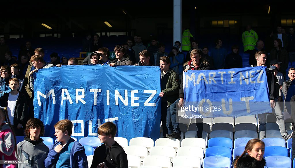 Everton supporters hold banners 'Martinez Out'' after the Barclays Premier League match between Everton and A.F.C. Bournemouth at Goodison Park on April 30, 2016 in Liverpool, England.