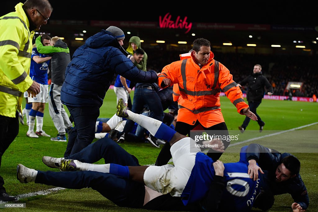 Everton supporters invade into the pitch to celeberate their team's third goal during the Barclays Premier League match between A.F.C. Bournemouth and Everton at Vitality Stadium on November 28, 2015 in Bournemouth, England.