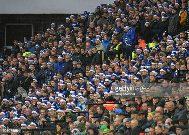 Everton supporters wearing Santa Claus hat are seen on the stand during the Barclays Premier League match between Norwich City and Everton at Carrow...