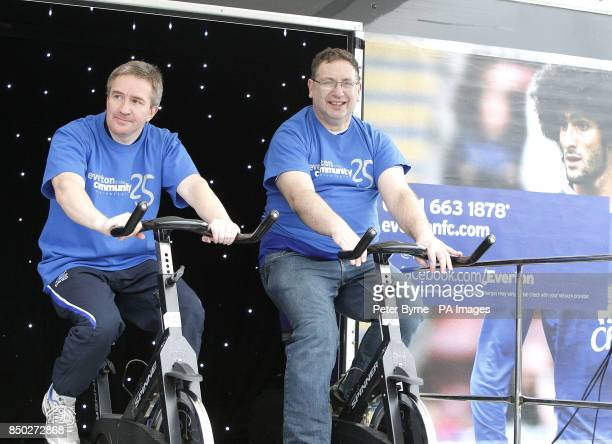Everton supports ride exercise bikes for donations during the Everton Roadshow outside Goodison Park