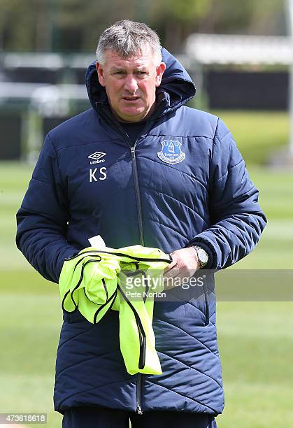 Everton U18 manager Kevin Sheedy looks on during the pre match warm up prior to the U18 Premier League match between Manchester City and Everton at...