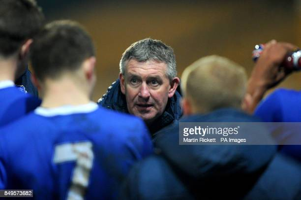 Everton youth team manager Kevin Sheedy talks to his players
