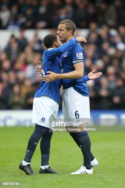 Everton's Aaron Lennon and Phil Jagielka embrace